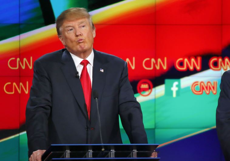 Republican U.S. presidential candidate businessman Donald Trump reacts during the Republican preside