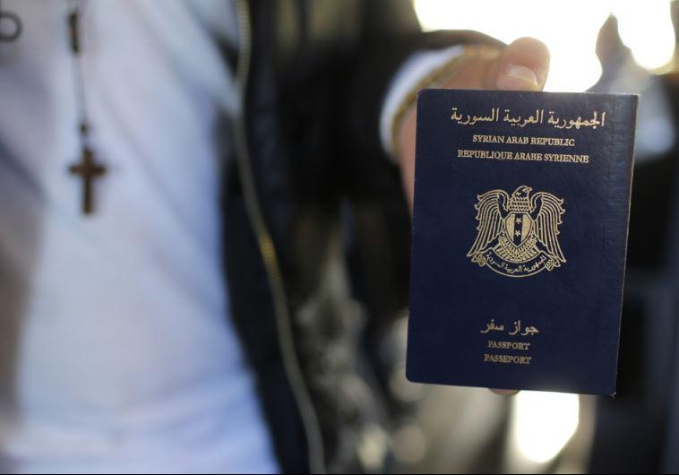 Christian Syrian refugee Ghassan Aleid displays his Syrian passport