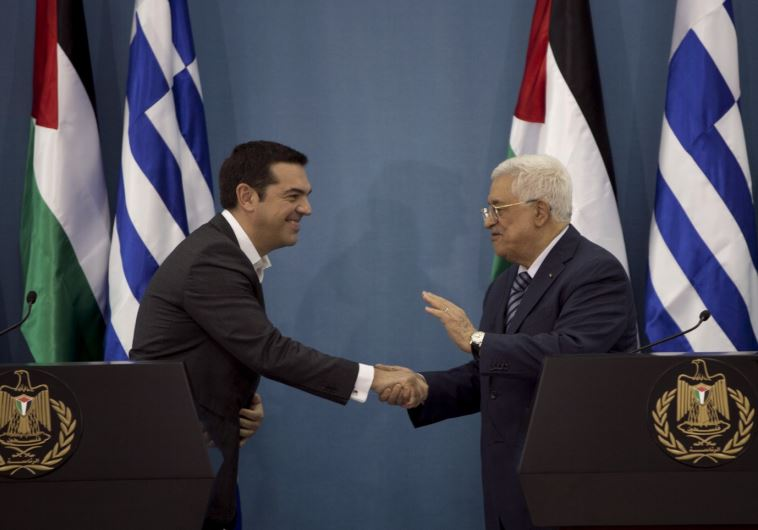 Greek Prime Minister Alexis Tsipras (L) shakes hands with PA President Mahmoud Abbas