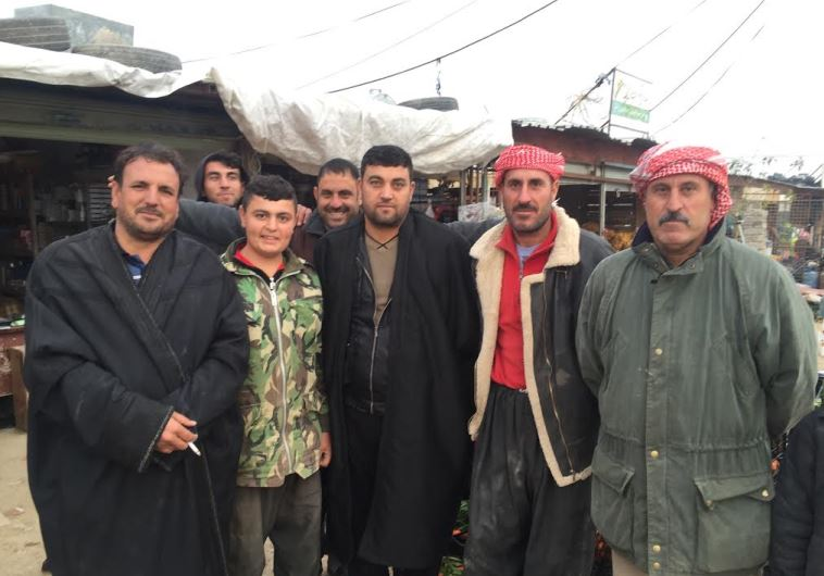 Yazidi men in Snune, one of the few villages some people returned to