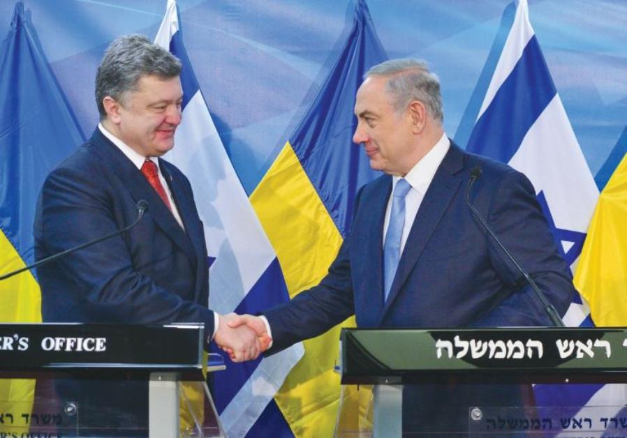 PRIME MINISTER Benjamin Netanyahu greets Ukrainian President Petro Poroshenko in Jerusalem