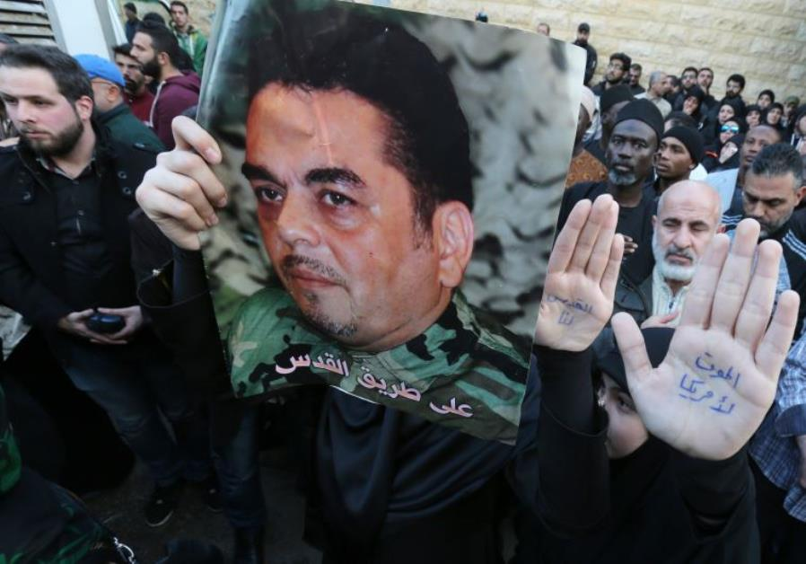 Lebanese mourners hold portraits of Lebanese militant Samir Kantar during his funeral procession