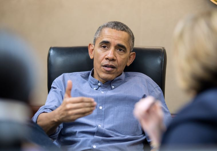 US President Barack Obama meets with staff in the White House Situation Room