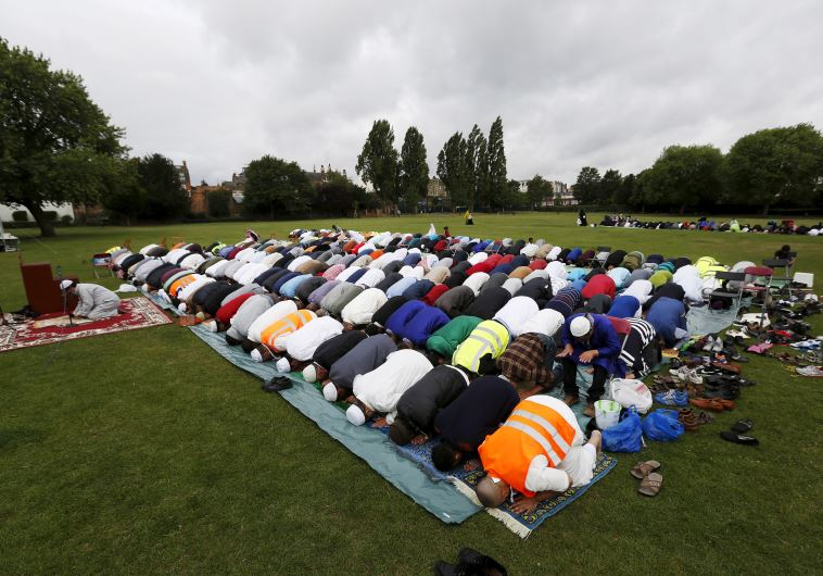 Muslims perform prayers for Eid-al Fitr to mark the end of the holy fasting month of Ramadan