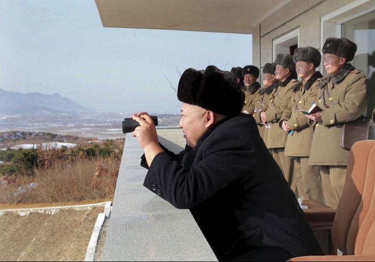 North Korean leader Kim Jong Un watches maneuvers