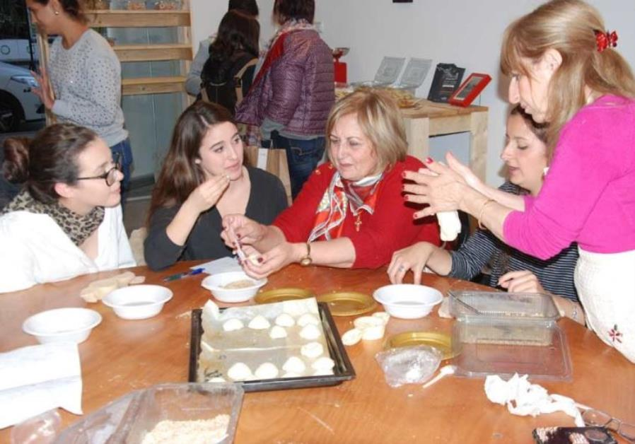 Baking cookies with the women of the Rameh Orthodox Christian Church.