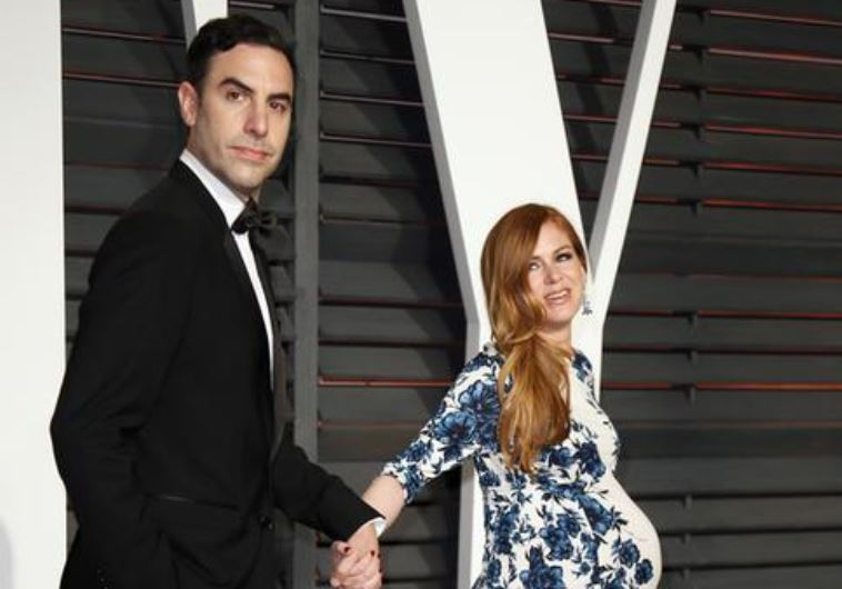 Actors Sasha Baron Cohen and Isla Fisher arrive at the 2015 Vanity Fair Oscar Party in Beverly Hills