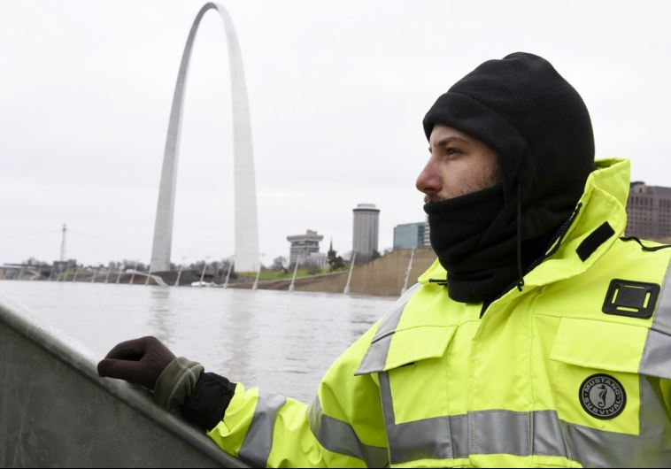 US Geological Survey (USGS) hydro technician Jason Carron assesses the Mississippi River flood water