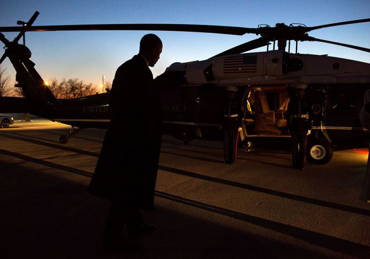 President Barack Obama boards Marine One at the Hope landing zone for departure en route to Chicago