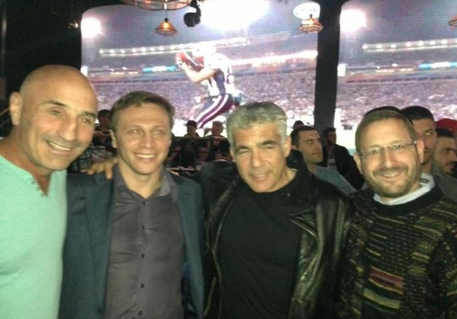 Lapid with Yesh Atid lawmakers at 2015 Super Bowl party