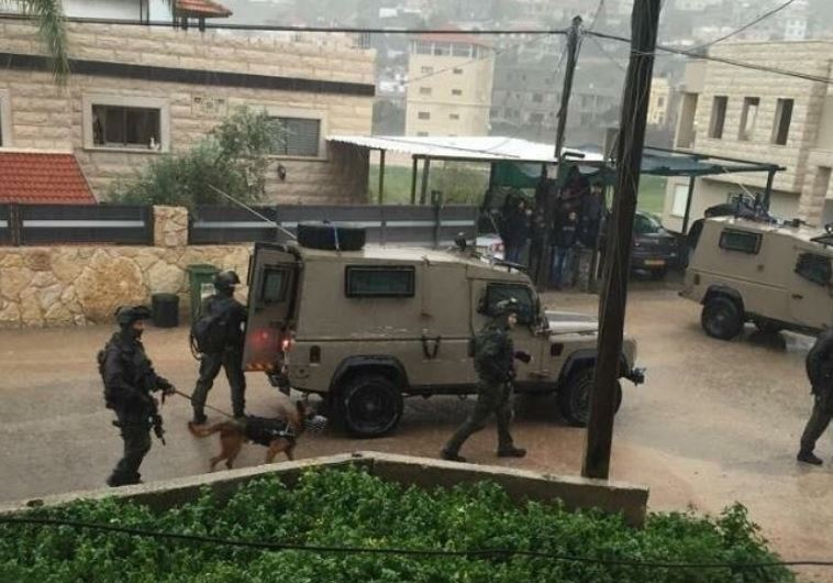 Security forces search for Nashat Milhem in the Israeli Arab village of Arara