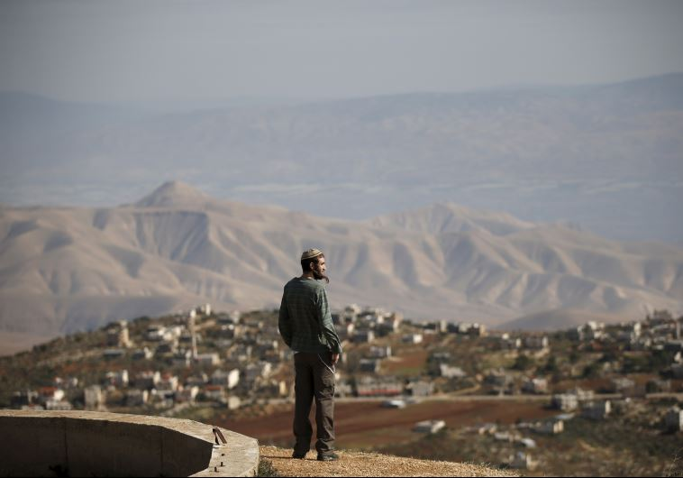 Settler Refael Morris stands at an observation point overlooking the West Bank village of Duma