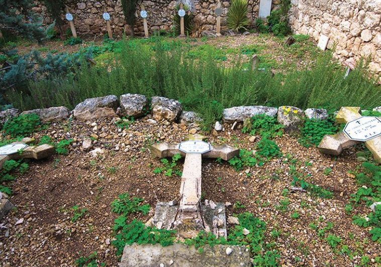 THESE CRUCIFORM TOMBSTONES were found knocked over at the Beit Jamal monastery, the result of one of