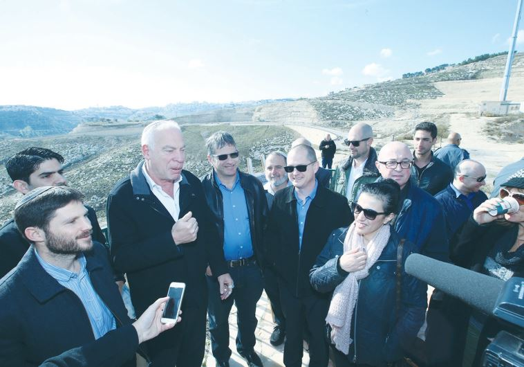 AGRICULTURE MINISTER Uri Ariel speaks at the E1 site in Ma'aleh Adumim yesterday