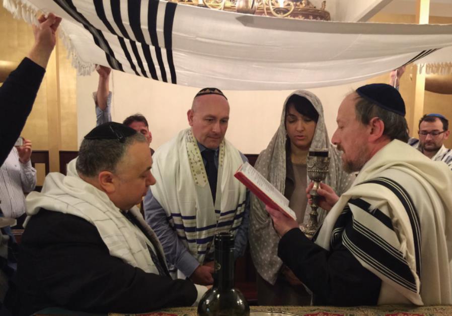 Chief Rabbi of Genoa Giuseppe Momigliano recites the blessing while Chief Rabbi of Naples