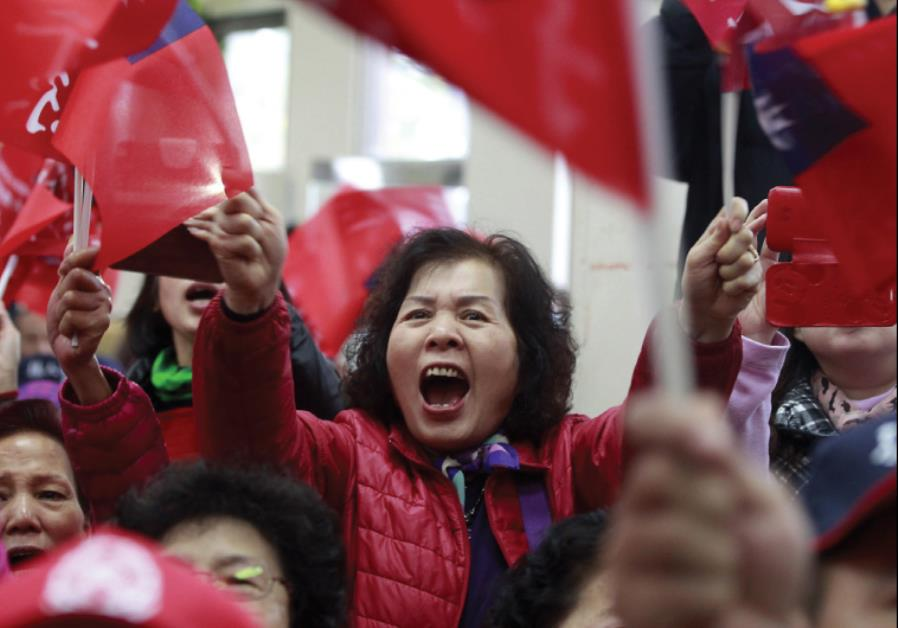 ENTHUSIASTIC SUPPORTERS of Taiwan's ruling Nationalist Kuomintang Party (KMT) chairman Eric Chu wave