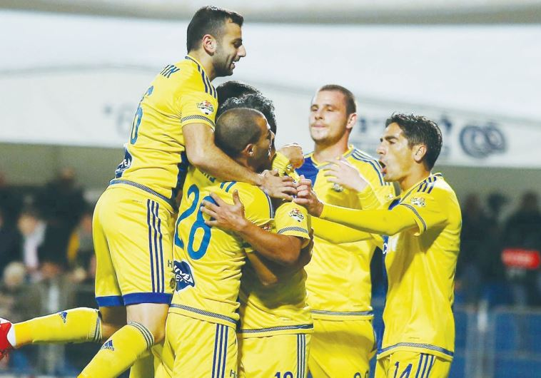 Maccabi Tel Aviv players celebrate after securing their place in the State Cup last-16
