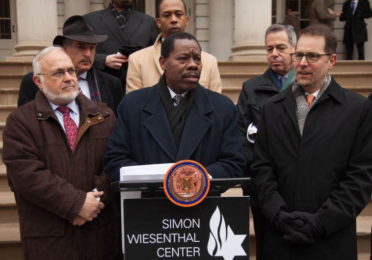 Rabbi Abraham Cooper, Assembly Member David I. Weprin, speaking at the podium Council Member Mathieu