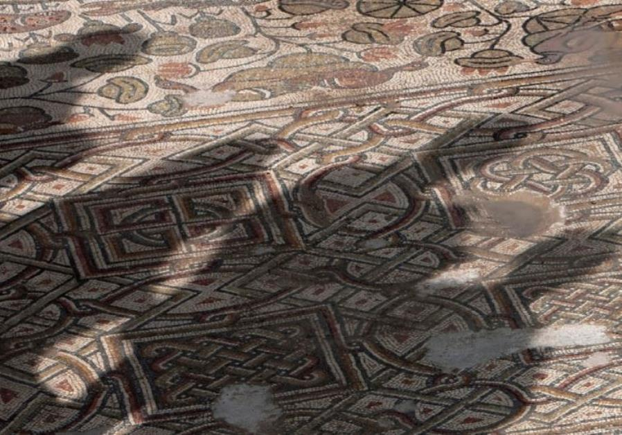 THE SHADOW of members of the media is cast on a mosaic floor of an ancient church.