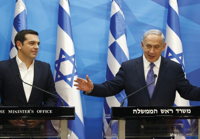 BENJAMIN NETANYAHU gestures as he delivers a joint statement with his Greek counterpart.