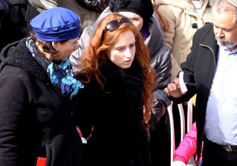 Renana Meir, daughter of slain terror victim Dafna Meir, attends her mother's funeral in Jerusalem -