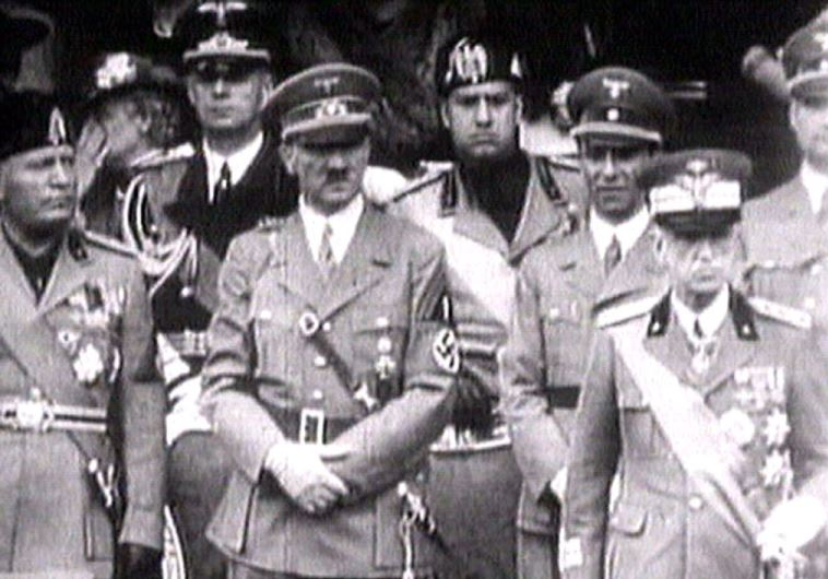 King Victor Emanuel III, (R) Adolf Hitler (C) and Benito Mussolini (L) watch fascist troops