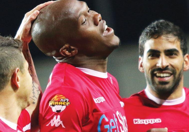 Hapoel Beersheba striker Anthony Nwakaeme (center) celebrates with teammates after scoring a goal