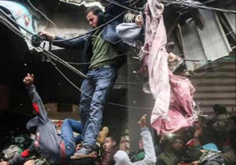 Palestinians in Gaza during a roof collapse