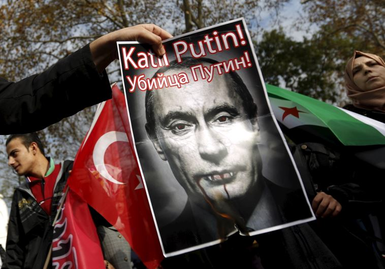 Pro-Islamist demonstrators set fire to a defaced poster of Russia's President Vladimir Putin