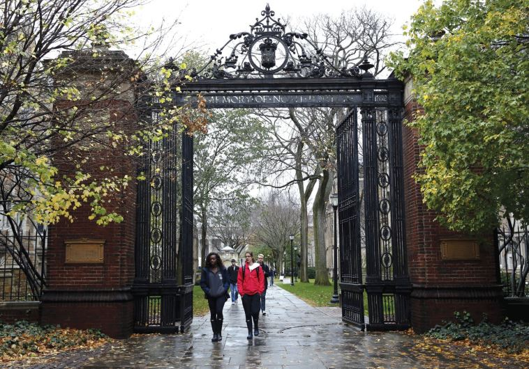 STUDENTS WALK on the campus of a university in Connecticut