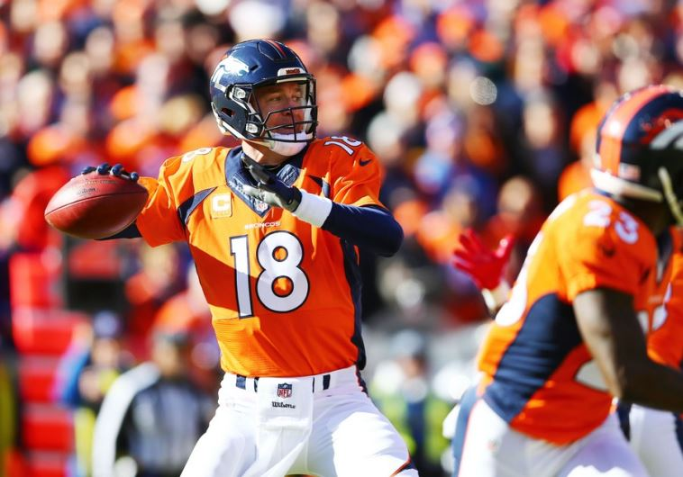 Denver Broncos quarterback Peyton Manning (18) drops back to pass against the New England Patriots