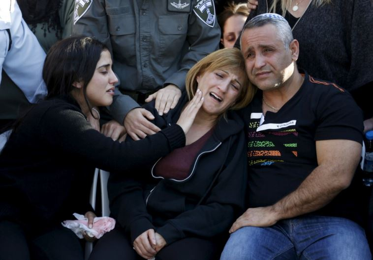 The parents of Border Policewoman, Hadar Cohen, 19, mourn during their daughter's funeral