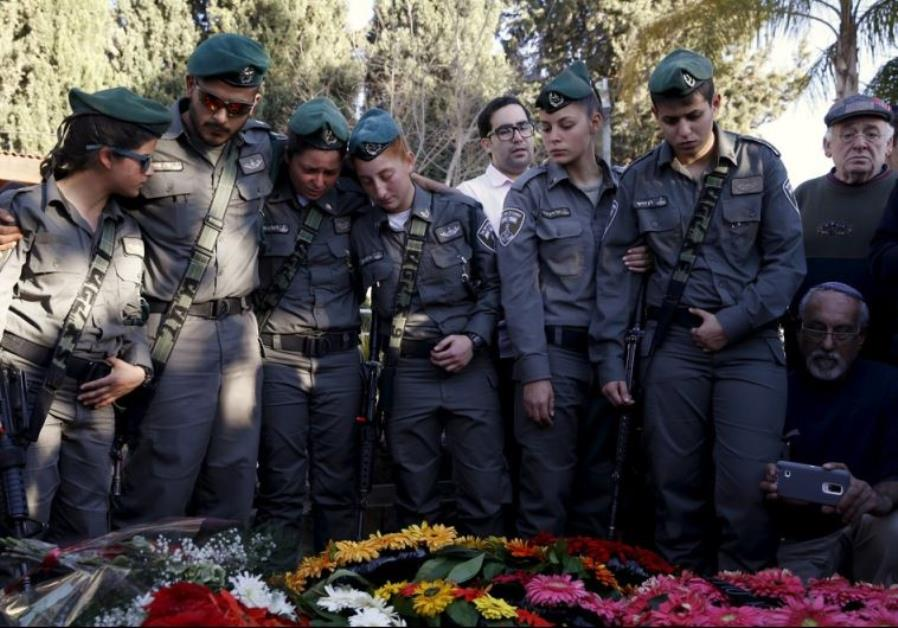 Comrades of Border Policewoman Hadar Cohen mourn during her funeral in Yehud