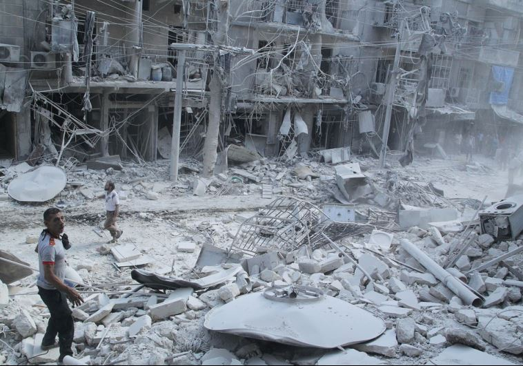 Residents look for survivors at a damaged site in Aleppo