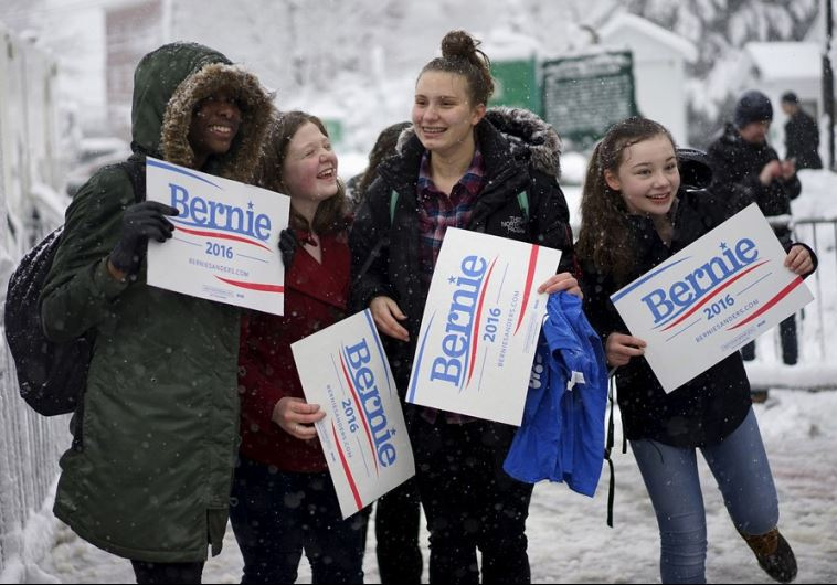 Girls supporting US Democratic presidential candidate Bernie Sanders cheer for Bernie