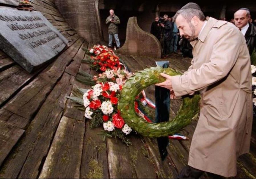 Ognjen Kraus, leader of Croatia's Jewish community, lays a wreath on the monument of Fascist victims