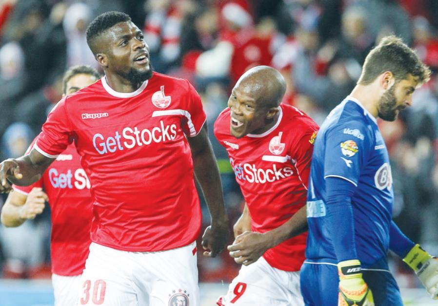 Hapoel Beersheba midfielder John Ogu (left) celebrates after scoring his team's second goal in last