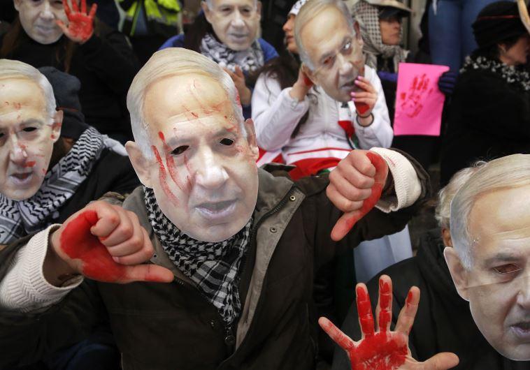 Anti-Israel demonstrators led by the protest group Code Pink wear masks of Prime Benjamin Netanyahu