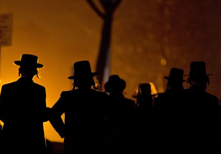 Hassidic Jews arrive at a mass gathering in Brooklyn