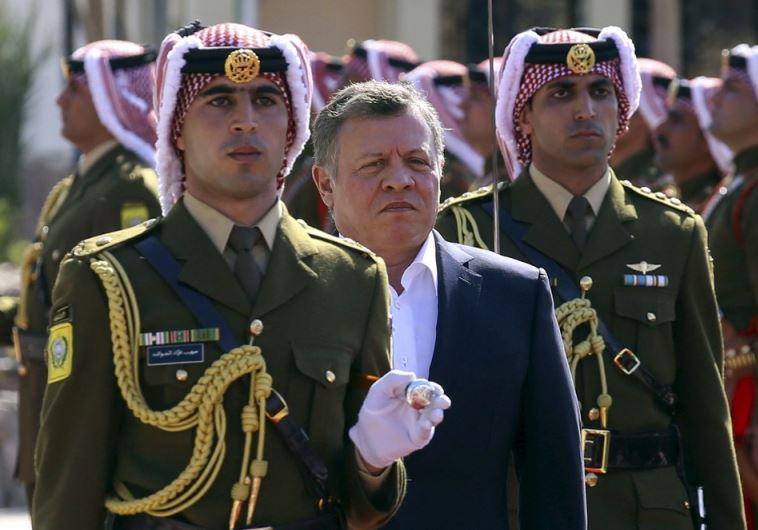 Jordan's King Abdullah II (2nd L) reviews an honor guard in Jordan's Red Sea port of Aqaba