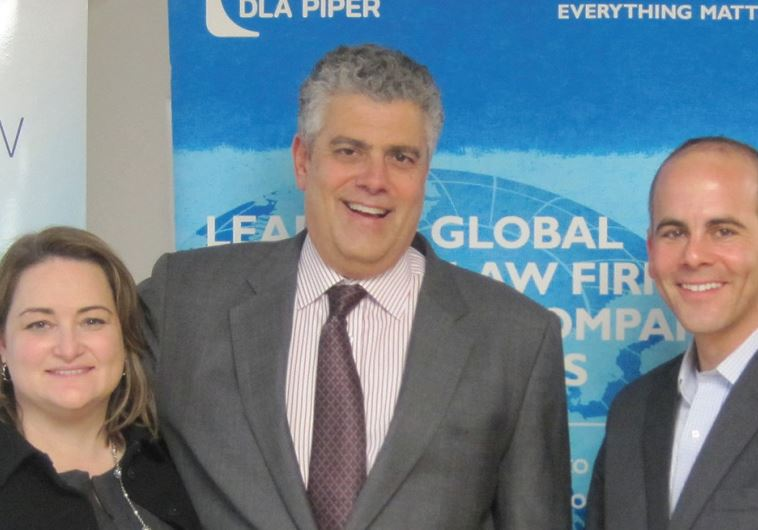 DLA PIPER ATTORNEYS Laura Flippin, Richard Chesley (center) and Jeremy Lustman smile at the seminar