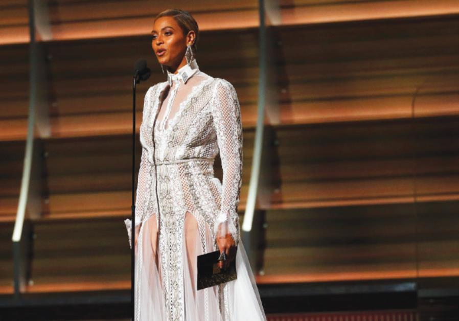 BEYONCE PRESENTS the Best Record of the Year award during the 58th Grammy Awards in Los Angeles.