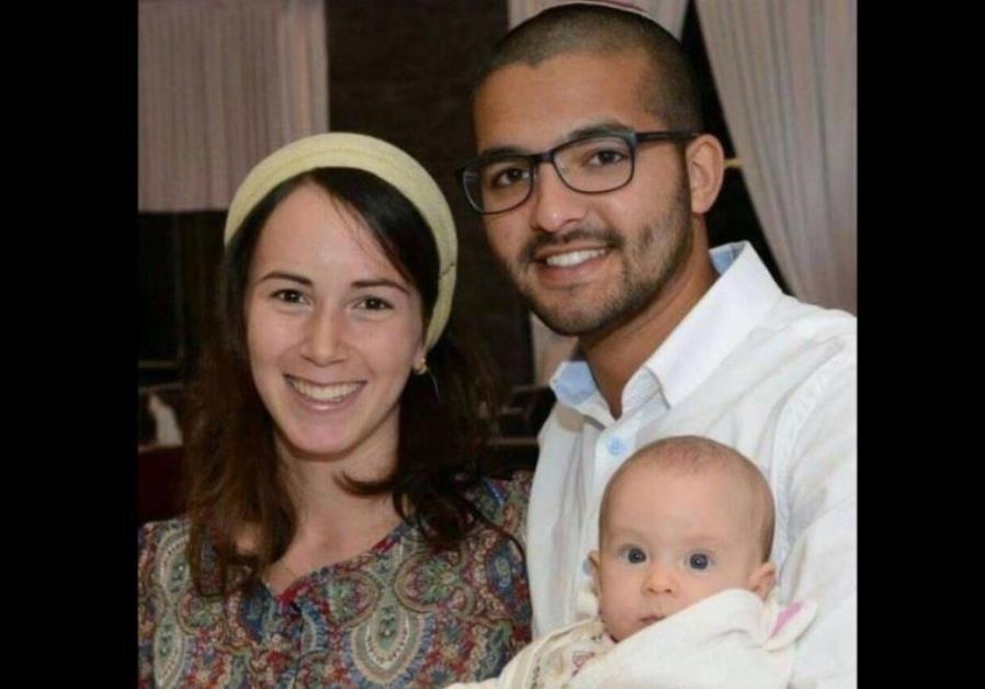 IDF Sgt. Tuvia Yanai Weissman (R), his wife, and baby