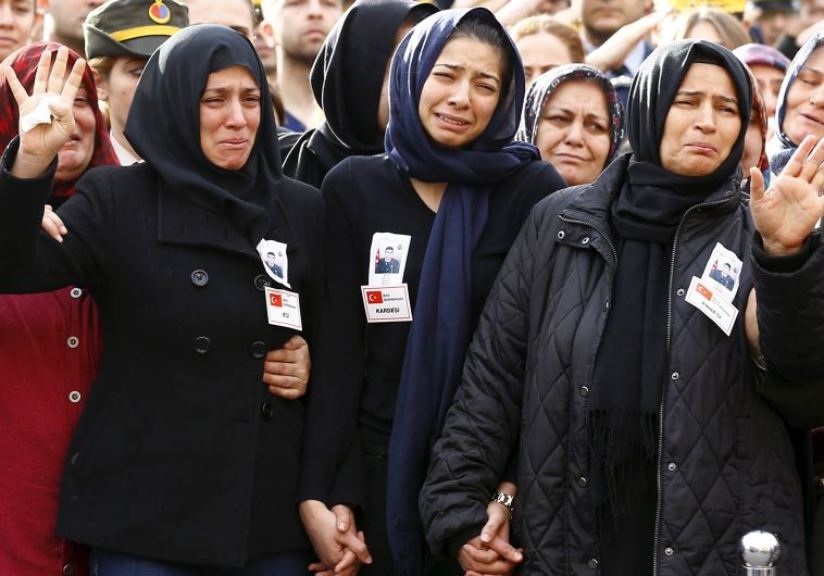 Family members of Army officer Seckin Cil, his mother Aysel (R), wife Beyza (L) and sister Busra (C)