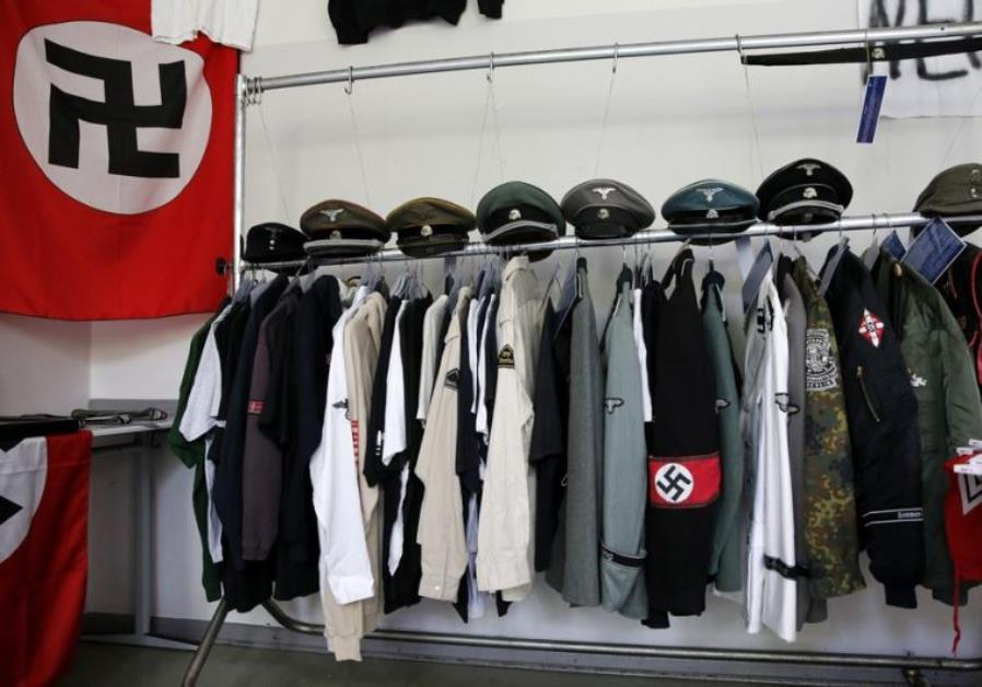 Nazi uniforms and a Swastika flag that were confiscated by the Berlin police