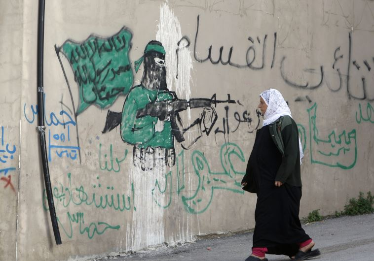"The graffiti reads ""All of us are martyrs."""