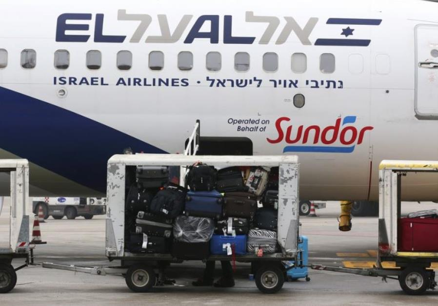 Baggage carts are seen on the tarmac near an El Al Israel Airlines plane at Venice airport