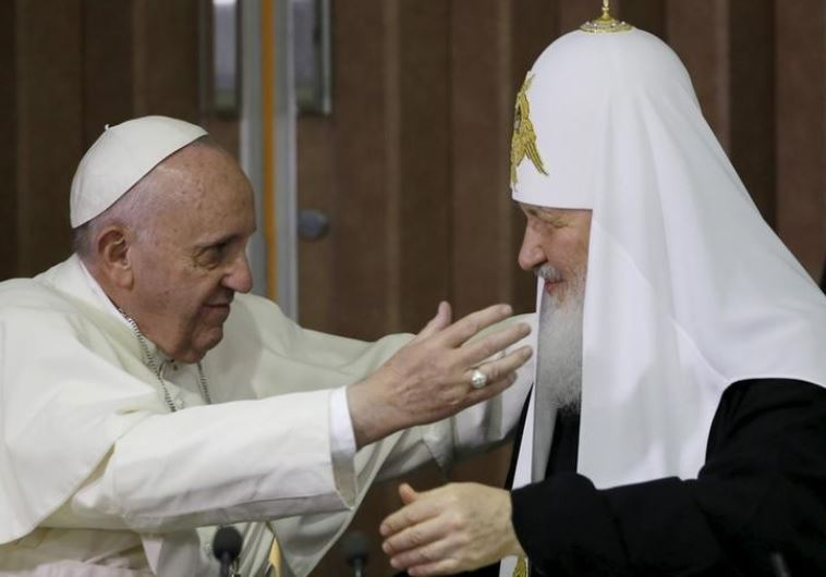 Pope Francis, left, reaches to embrace Russian Orthodox Patriarch Kirill after signing a joint decla