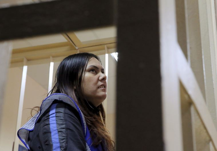 Gulchekhra Bobokulova, a nanny suspected of murdering a child in her care, looks on inside a defenda