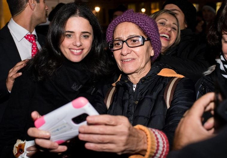 Justice Minister Ayelet Shaked (L) poses for a selfie picture with a Jewish Berliner